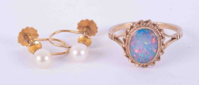 A 9ct gold and opal set ring, together with a pair of pearl 9ct gold earrings, each cased.