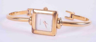 Gucci gilt fashion watch (broken clasp).
