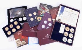 A collection of various commemorative coin sets including Age of the Windsor's, incomplete, Normandy