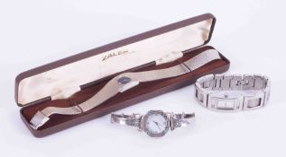 Three ladies watches including fashion watches, DKNY and Gillex.
