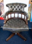 A office leather upholstered swivel chair.