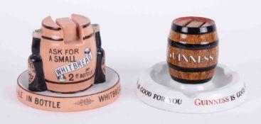 A Minton's match striker advertising Guinness and another match striker ashtray advertising
