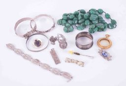 A bag of costume jewellery to include green hardstone beads, silver bangles, gilt metal pendant