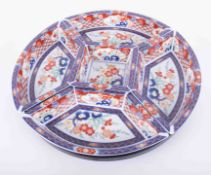 A modern Imari sectional serving dish, on lazy Susan, diameter 38cm on revolving tray.