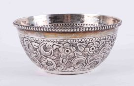 A Continental silver sugar bowl with embossed decoration, 86gms.