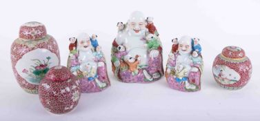 """Three reproduction Chinese porcelain """"Buddha Boys"""", figures, together with three ginger jars."""