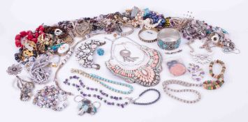 A bag of various costume jewellery.