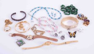 A bag of various costume jewellery, including bangles, bracelets Lorus and other ladies watches.