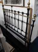 An antique brass and iron metal bed frame, height head frame 133cm and width of head frame 120cm.
