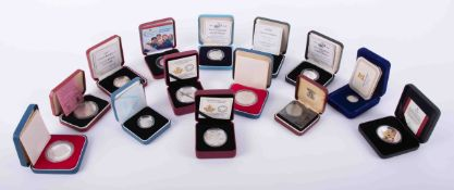 A collection of fourteen various silver and other commemorative coins including two Royal Mint,