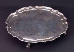 A modern silver waiter on four curl feet, 16cm diameter, 186gms.