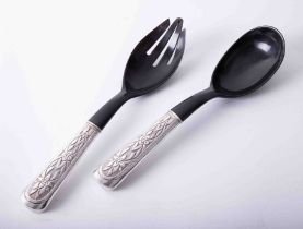 Matched pair of silver handled salad servers, each handle with embossed foliate decoration and