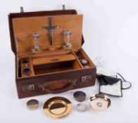 A communion cased set, fitted with an arrangement of various silver containers, EP candlesticks,