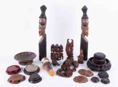 A mixed collection of African and other carvings, Oriental clock stands, face masks, etc.