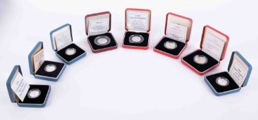 Royal Mint, four silver proof one pound coins, two silver proof fifty pence coins and two silver