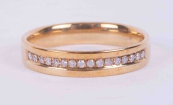 A 9ct yellow gold half eternity style ring set with 0.10 carats (total weight) of round brilliant