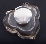 A silver and shaped glass inkwell, approx. 12cm x 13cm.
