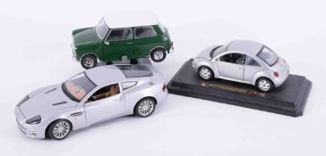 A collection of model cars including Burago, Maisto, Vanguards etc, approx 30.