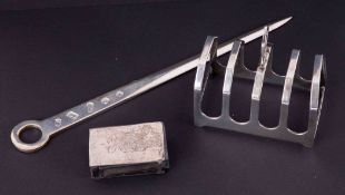 A silver meat skewer 58gms, George V silver five bar toast rack 58gms and a silver matchbox case (