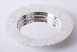 Silver communion patten with ecclesiastical engraved raised border dimensions 7.5 dia x 3cm.