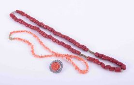 """Two coral necklaces, one dark coral, length approx 21"""" and one light coral, length approx. 14"""" and a"""