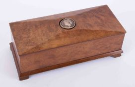 A 20th Century burr walnut box with carved portrait set in the lid, length 25cm.