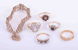 A bag of mixed 9ct yellow gold jewellery to include four x gem set rings, total weight 10.57gm & a