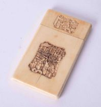 An antique Chinese carved ivory card case decorated with a panel of figures, 9.5cm x 5.5cm.