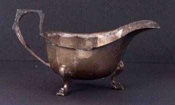 A George V silver cream jug with wavey rim, 91gms.