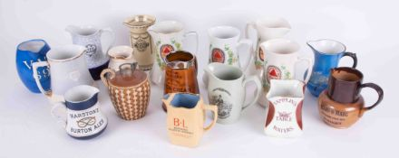 A collection of 17 various pub jugs including a group of 3 Pale Ale jugs, also Blundel's Whisky