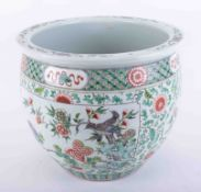 A large 19th century Chinese Famille Verte jardiniere, height 34cm (some cracking, repaired).