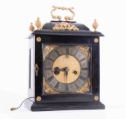 An English ebonised bracket clock, signed Tho (Thomas) Taylor, in Holborne, with eight day twin