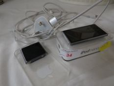 Apple Ipod nano together with an Ipod shuffle, charger and headphones.