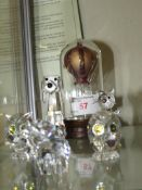 Five Swarovski animal figures together with a glass ornament of hot air balloon.
