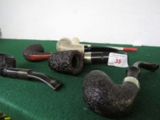 Six vintage tobacco pipes including K & P, one with silver band and a clay example.