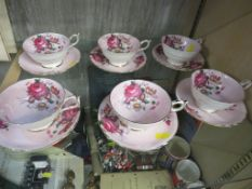 SET OF SIX PARAGON CHINA TEA CUPS AND SAUCERS IN A FLORAL PATTERN.
