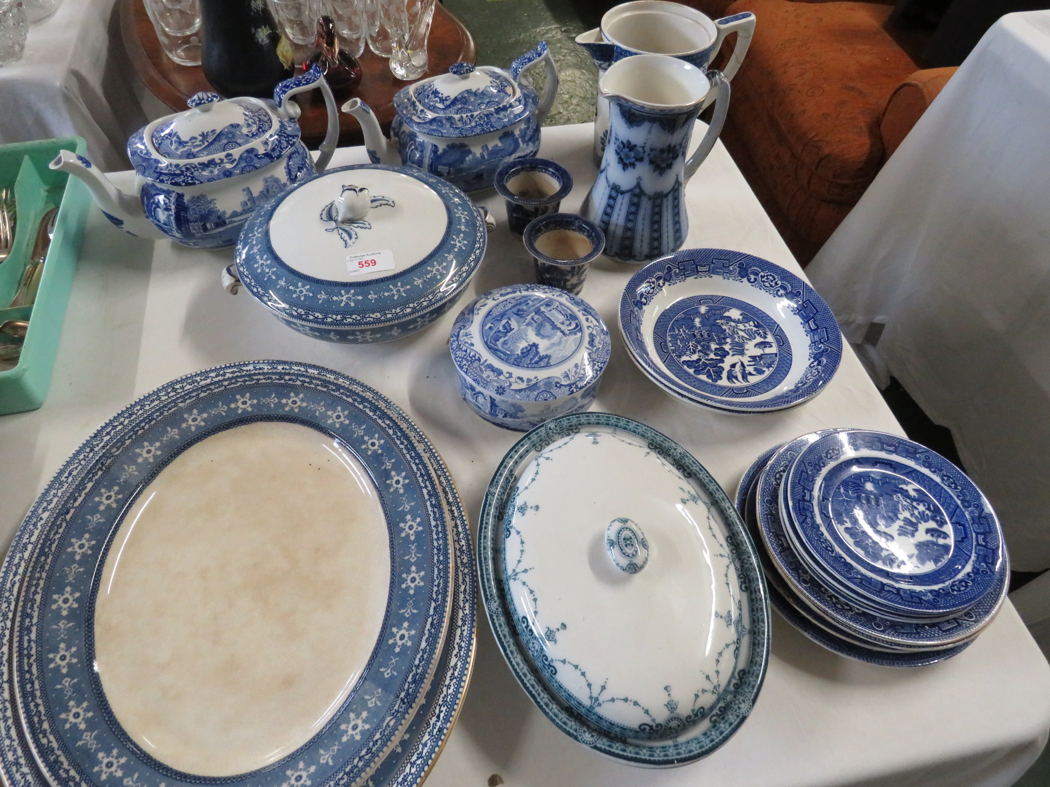 BLUE AND WHITE PATTERN CHINA INCLUDING TEA POTS , JUGS , CHARGERS ETC.