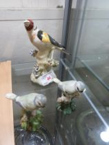 POTTERY FIGURE OF A GOLD FINCH ON BRANCH, TOGETHER WITH A PAIR OF STAFFORDSHIRE STYLE OF FIGURES