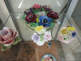 CERAMIC POSIES INCLUDING COALPORT AND BOOTHS, TOGETHER WITH A CHAMBER STICK IN THE FORM OF A ROSE.