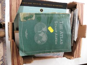 THE ATLAS STAMP ALBUM, A BLUE STOCK ALBUM, TRAFALGAR STAMP COLLECTION LIMITED EDITION ALBUM, AND A