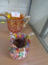CARNIVAL GLASS JUG AND ONE OTHER COLOURED GLASS JUG.
