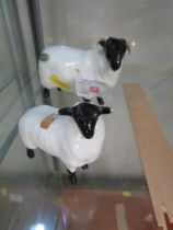 BESWICK FIGURE OF A HORNED SHEEP TOGETHER WITH LAMB. (AF)