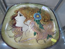 STUDIO POTTERY SQUARE DISH DEPICTING LADIES HEAD IN PROFILE WITH HAIR ADORNED WITH FLOWER, SIGNED