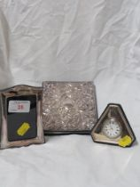 SMALL SILVER CLAD PHOTOGRAPH FRAME , EMBOSSED SILVER CLAD ADDRESS BOOK , AND A SILVER CLAD