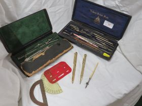 TWO CASED SETS OF DRAWING INSTRUMENTS. (AF) GOLD PLATED PROPELLING PENCIL AND OTHER SMALL ITEMS.