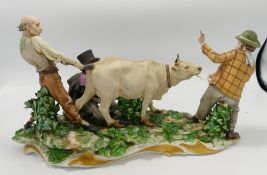 Capodimonte figure group of tramps milking cow: damage noted,