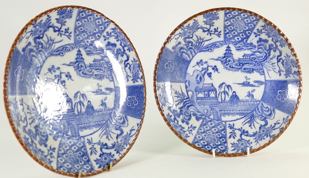 Early 20th century Japanese porcelain pair of blue willow plaques: Diameter 24cm.