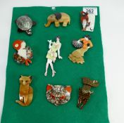 A set of nine modern brooches: (9)