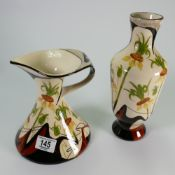 Black Ryden vase and ewer decorated with flowers: tallest height 26cm.