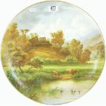 Earthenware charger handpainted with Cattle outside Norham castle: early 20th century,